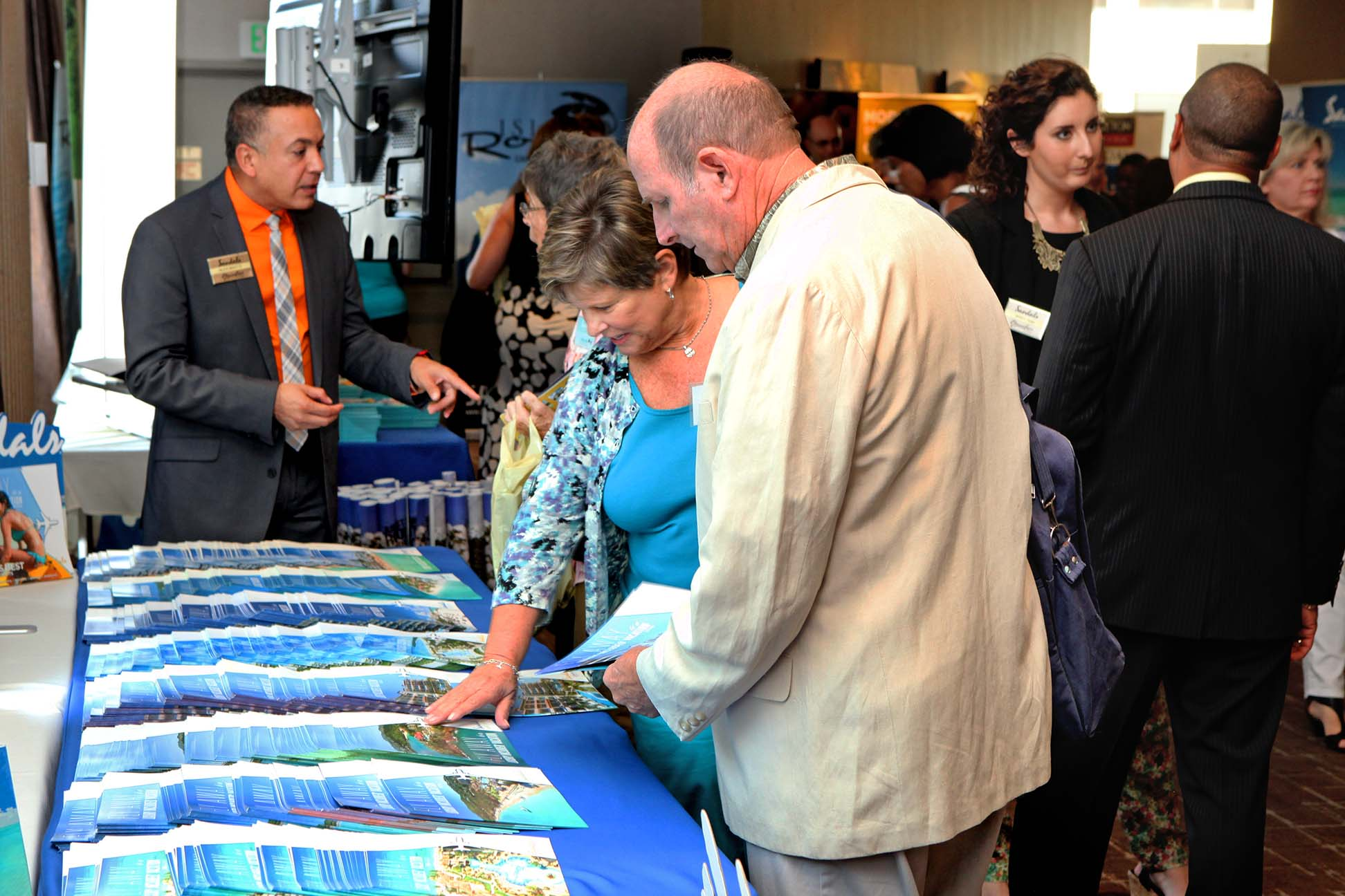 travel agents checking brochures